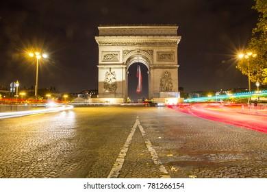 The Arc de Triomphe de l'Étoile is one of the most famous monuments in Paris, standing at the western end of the Champs-Élysées at the center of Place Charles de Gaulle.
