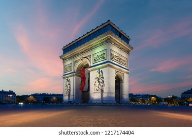 Arc de Triomphe Paris and Champs Elysees with a large France flag flying under the arch in Europe victory day at Paris, France.