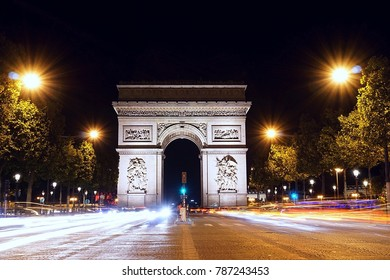 Arc de Triomphe in Paris in the evening  and street view from Champs-Elysees France