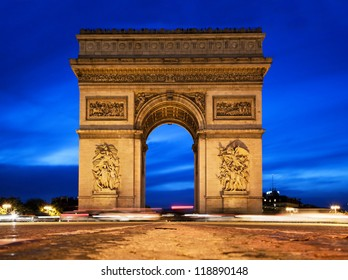 Arc de Triomphe, Paris, France at night. View from Avenue des Champs-Elysees