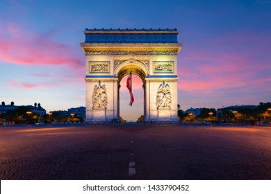 Arc de Triomphe de Paris at night in Paris, France. Landscape and Landmarks travel, or historical building and sightseeing in Europe concept