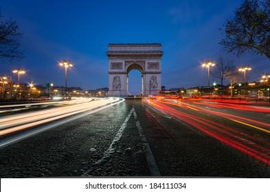 The Arc de Triomphe in Paris at night.