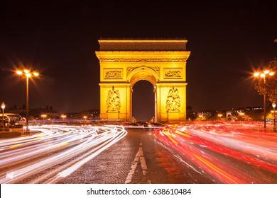 Arc de Triomphe - Paris traffic on Champs-Elysees at nigh