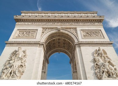 Arc de Triomphe in Paris under sky with clouds
