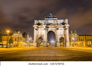 Arc de Triomphe at the Place du Carrousel and Louvre museum in Paris illuminated in the evening