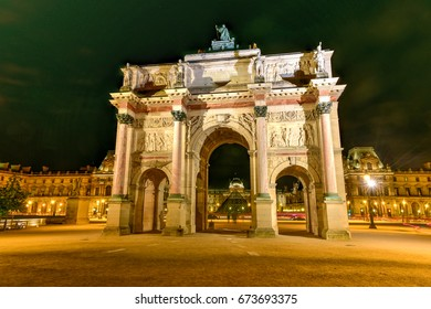 Arc de Triomphe at the Place du Carrousel in Paris at night.