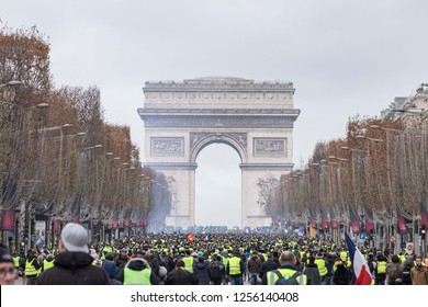 "Arc De Triomphe with thousands of people demonstrating during the ""Yellow Vests"" antigovernment protest in the French capital. Paris, France - December 8, 2018"