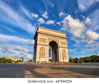 Arc de Triumph in Paris, France, on a bright afternoon with feather clouds behing, panoramic image.