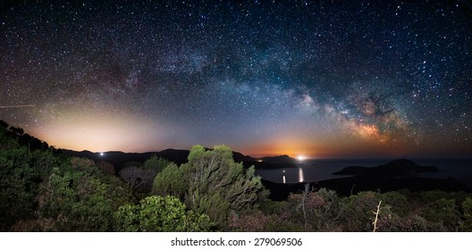 The arc of the Milky Way in a panoramic night view