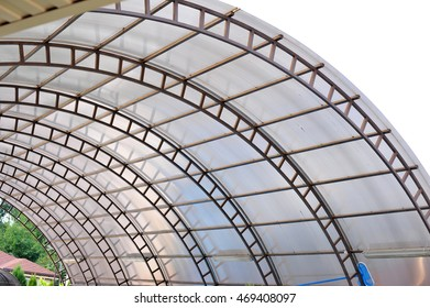 Arc polycarbonate canopy against a blue sky