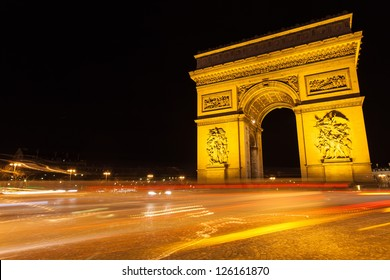 Arc of Triumph in Avenue of Champs-Elysees at night