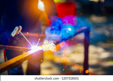 Arc welding iron steel structure on site building construction