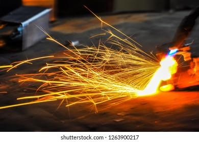 Arc welding of a steel,  tool and sparks