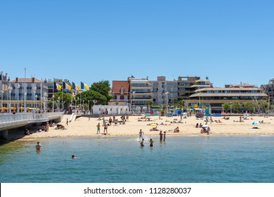ARCACHON, FRANCE, JUNE 23, 2018: the central beach in summer and the jetty Thiers