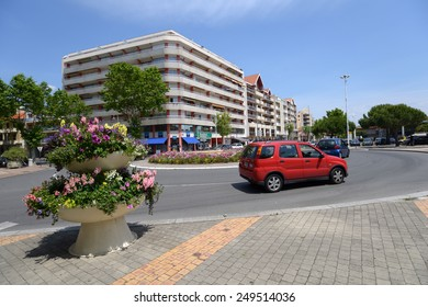"""ARCACHON, FRANCE - JUNE 27, 2013: Traffic on the Boulevard du General Leclerc. Arcachon was found in 1857, and is known for the """"Arcachonnaise"""", an architectural style of local villas"""