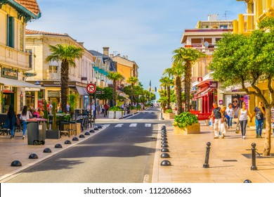 ARCACHON, FRANCE, MAY 15, 2017: Main pedestrian alley leading to a beach in the historical center of Arcachon, France