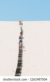 ARCACHON, FRANCE - May 17, 2018: People climbing on the Dune of Pilat