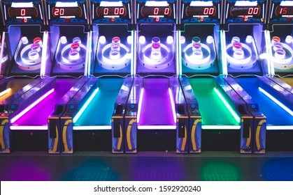 Arcade Game With Pink, Blue, Purple and Yellow Neon Lighting
