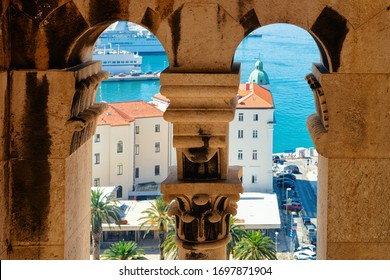 Arcade of walls in Diocletian Palace at Old city of Split on Adriatic Coast in Dalmatia in Croatia. Roman Town architecture and Croatian Dalmatian Bay seen through the arch. Europe tourism in summer.