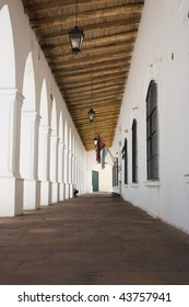 Arcade with white columns and wooden roof in Cachi, Argentina