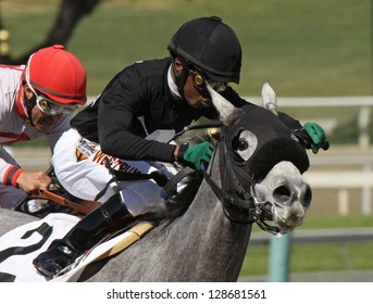 "ARCADIA, CA - FEB 16: Jockey Kevin Krigger pilots ""Sweetrayofsunshine"" to her 3rd straight win at Santa Anita Park on Feb 16, 2013 in Arcadia, CA."