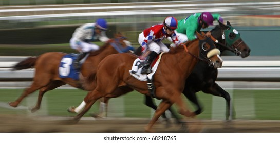 ARCADIA, CA - JAN 1: A trio of jockeys surges down the homestretch in the first race at Santa Anita Park on New Year's Day, Jan 1, 2011 in Arcadia, CA.