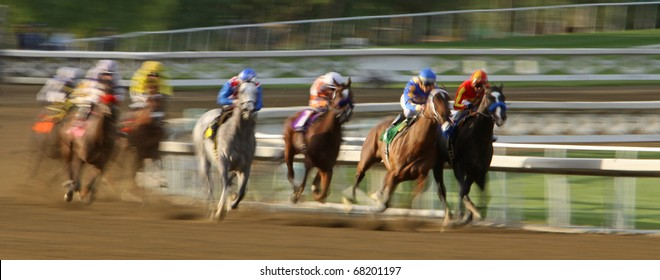 ARCADIA, CA - JAN 1: Two jockeys vie for the lead at the top of the stretch in the 7th race at Santa Anita Park on Jan 1, 2011 in Arcadia, CA.