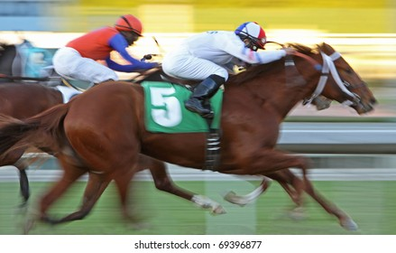 ARCADIA, CA - JAN 15: Jockeys Joel Rosario (white silks) and Kerwin John (red & blue silks) battle for the lead in a maiden claiming race at Santa Anita Park on Jan 15, 2011 in Arcadia CA.