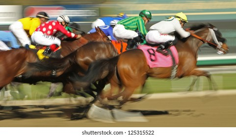 """ARCADIA, CA - JAN 17: The field flies down the homestretch in a claiming race at Santa Anita Park on Jan 17, 2013 in Arcadia, CA. Winner is Kevin Krigger (black cap on rail) and """"Sweetrayofsunshine""""."""