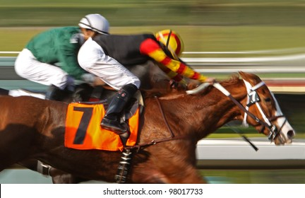 """ARCADIA, CA - MARCH 15: Christian Santiago Reyes and """"Siempre Esperanza"""" surge ahead to place 2nd in a maiden race at Santa Anita Park on March 15, 2012 in Arcadia, CA."""