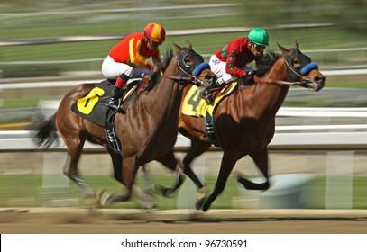 "ARCADIA, CA - MARCH 3: Jockey Martin Garcia and ""Mile High Magic"" (#6) move up on Rafael Bejarano and ""Eaton Hall"" to win a maiden race at Santa Anita Race Track on March 3, 2012 in Arcadia, CA."