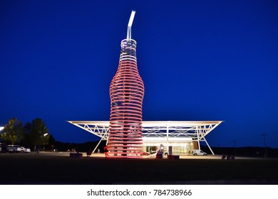 Arcadia, Oklahoma - July 19, 2017: Drive down on route 66 through Arcadia, Oklahoma, and you canÃ?t miss the neon, 66-foot-tall soda bottle in front of POPS. The biggest bottle of soda in the world