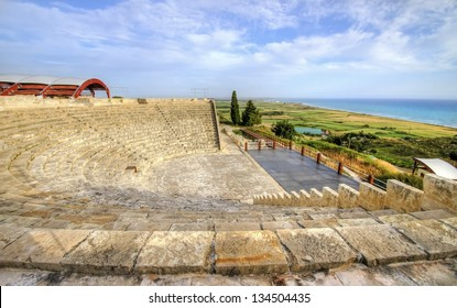 The arcaeological site of the ancient city of Kourio which is located in the district of Limassol, Cyprus. A view of the ancient theatre and the beach from the hill.