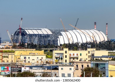 ArcelorMittal (formerly Ilva) - Coverage works of the mineral parks. View of the Tamburi neighborhood of Taranto, Puglia, Italy - 25/03/2019