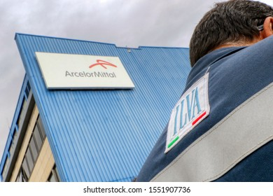 ArcelorMittal (formerly Ilva) steel industry with a worker in the former Ilva work overalls. Taranto, Puglia, Italy - 05/11/2019
