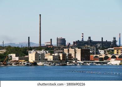 ArcelorMittal steelworks company (formerly Ilva) with neighborhood Tamburi of Taranto, Puglia, Italy