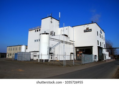 Arcen, Limburg, The Netherlands - February 28, 2018: Hertog Jan beer brewery against a clear blue sky.
