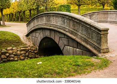 Arch bridge and fish channel in catherine park in autumn, Pushkin, Russia