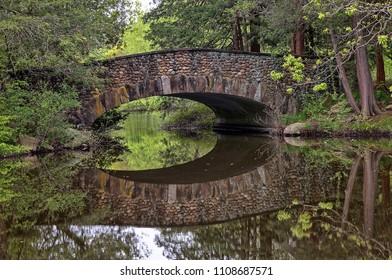 Arch Bridge over still water