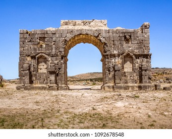 The Arch of Caracalla, the entrance gate of Volubilis site near Fez and Meknes, Morocco. UNESCO world heritage site