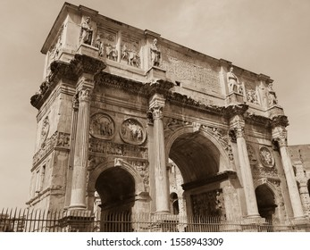 Arch of Constantine or Arco di Costantino. Historical roman structure, triumphal arch, victory at Battle of Milvian Bridge, made up of three decorated arches. Black and white sepia tone photography.