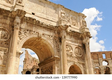 Arch of Constantine framing Colosseum on a sunny day in Rome, Italy