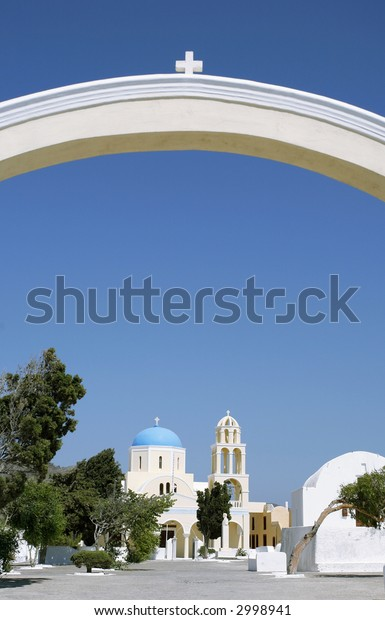 The arch at the entrance to a Greek Orthodox religious community's church compound on the Aegean holiday island of Santorini.