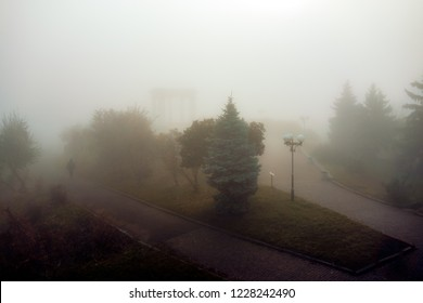 Arch of Friends in Poltava, Ukraine deem image in the fog. Autumn park view