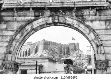 Arch of Hadrian overlooking Acropolis, Athens, Greece. It is one of the main tourist attractions of Athens. Black and white vintage photo of ancient Greek monument in Athens.