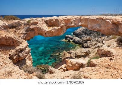 The Arch of Korakas (Kamara tou Koraka), the most impressive natural bridge of Cyprus, located in the northeast coast of Cape Greko (Cape Greco) Cyprus