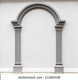 Arch molding decorates on the plain concrete wall.