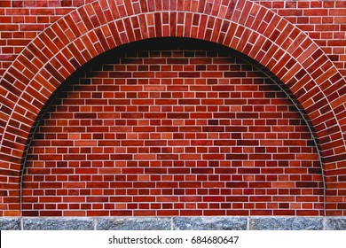 Arch od red brick wall artistic background, regular texture