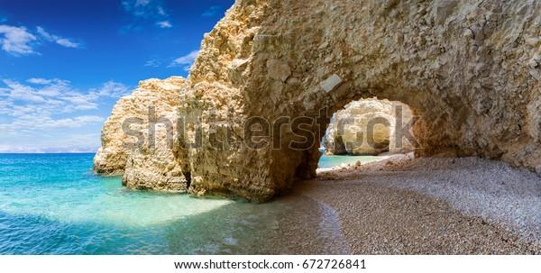The arch on Kasteli Beach in Kato Koufinisi, Greece