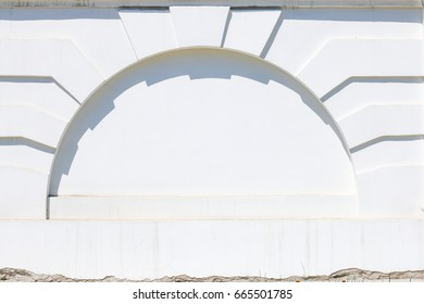 Arch on white concrete wall. White wall in form of arch.